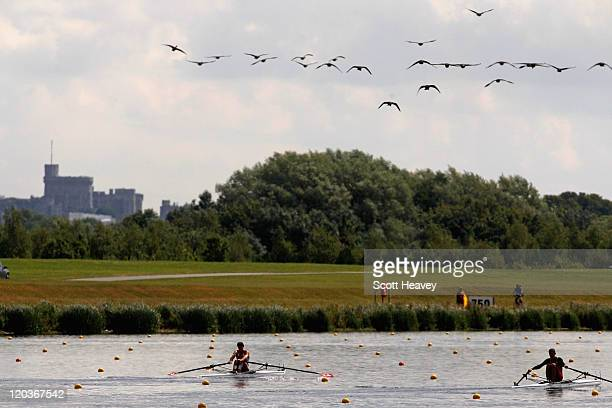 Augustin Maillefer of Switzerland and Aurimas Adomavicius of Lithuania in action during the Junior Men's Single Sculls on day three of the FISA 2011...