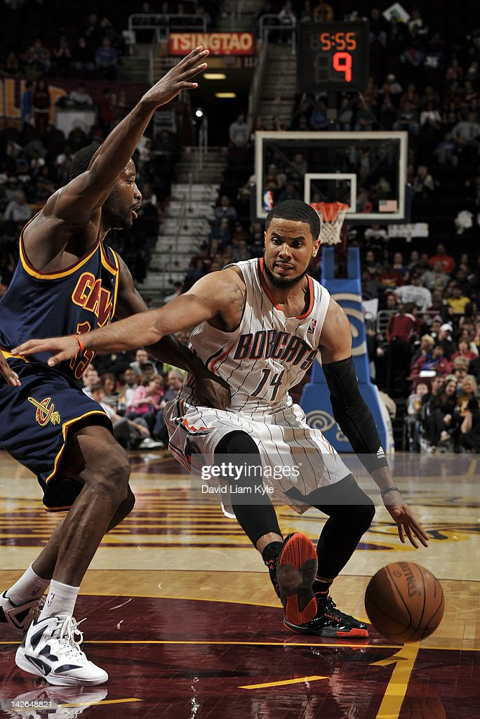 D.J. Augustin #14 of the Charlotte Bobcats drives to the basket against Donald Sloan #15 of the Cleveland Cavaliers at The Quicken Loans Arena on April 10, 2012 in Cleveland, Ohio.