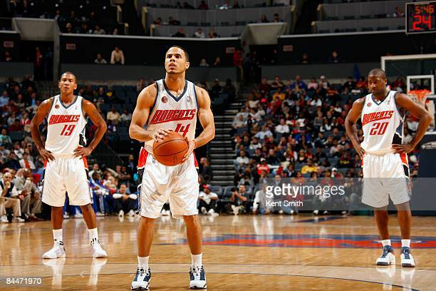 J Augustin of the Charlotte Bobcats shoots a free throw during the game against the Detroit Pistons on December 13 2008 at Charlotte Bobcats Arena in...
