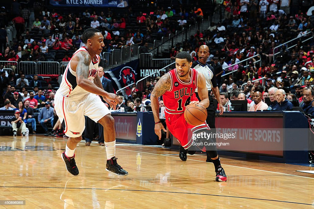 D.J. Augustin #14 of the Chicago Bulls drives against Jeff Teague #0 of the Atlanta Hawks on April 2, 2014 at Philips Arena in Atlanta, Georgia.