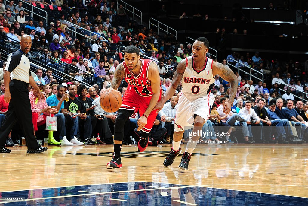 D.J. Augustin #14 of the Chicago Bulls drives to the basket against Jeff Teague #0 of the Atlanta Hawks on April 2, 2014 at Philips Arena in Atlanta, Georgia.