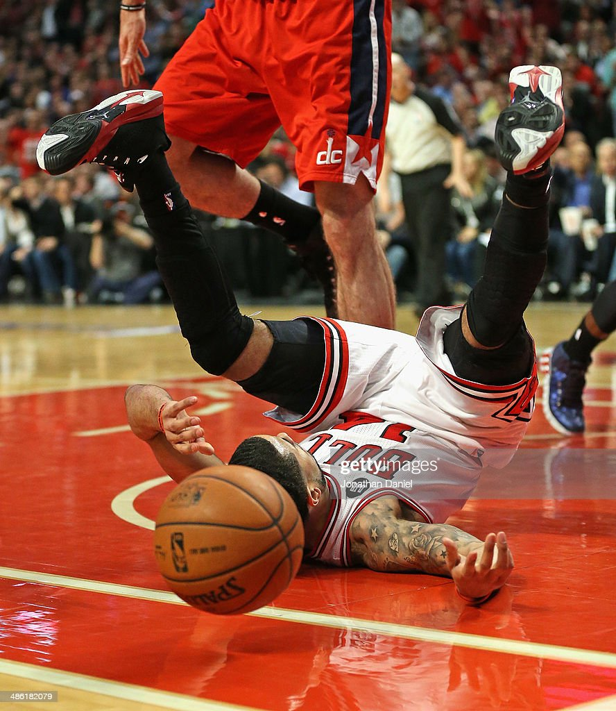 D.J. Augustin #14 of the Chicago Bulls ends up on his back after being fouled while driving the lane against the Washington Wizards in Game Two of the Eastern Conference Quarterfinals during the 2014 NBA Playoffs at the United Center on April 22, 2014 in Chicago, Illinois.