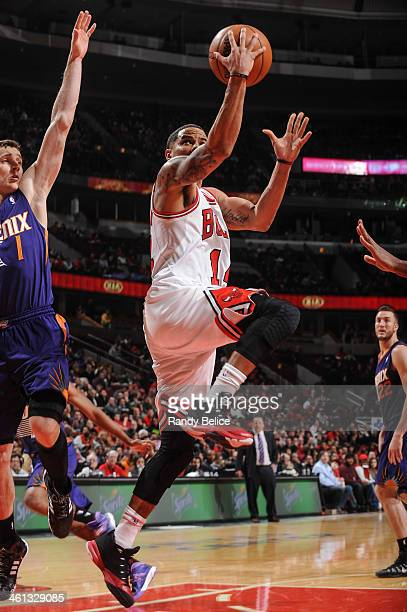 J Augustin of the Chicago Bulls shoots the ball past Goran Dragic of the Phoenix Suns on January 07 2013 at the United Center in Chicago Illinois...