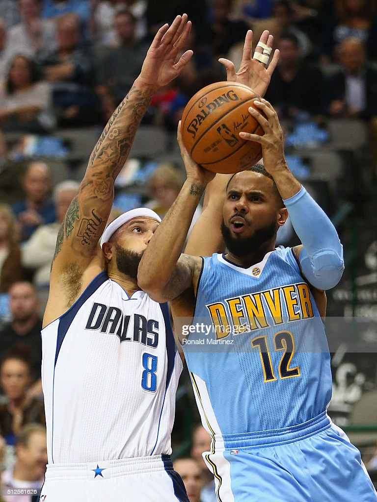 D.J. Augustin #12 of the Denver Nuggets is fouled by Deron Williams #8 of the Dallas Mavericks during the first half at American Airlines Center on February 26, 2016 in Dallas, Texas.