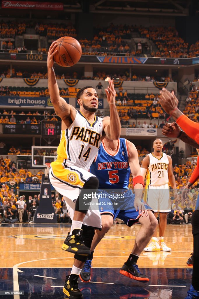 D.J. Augustin #14 of the Indiana Pacers drives to the basket against Amar'e Stoudemire #1 of the New York Knicks in Game Six of the Eastern Conference Semifinals during the 2013 NBA Playoffs on May 18, 2013 at Bankers Life Fieldhouse in Indianapolis, Indiana.