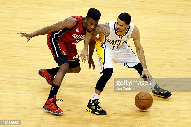 J Augustin of the Indiana Pacers in actiona against Norris Cole of the Miami Heat in Game Six of the Eastern Conference Finals during the 2013 NBA...