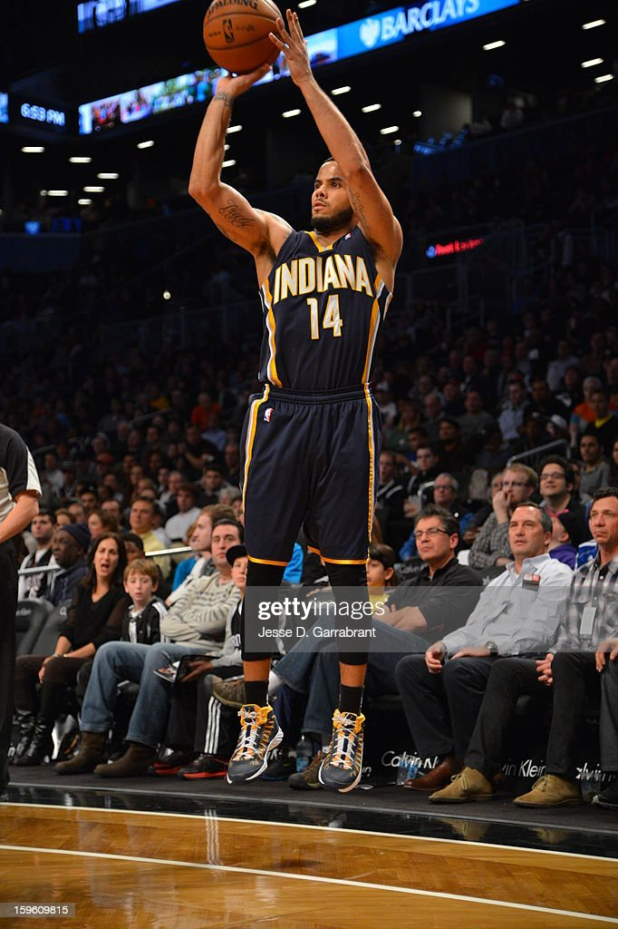 D.J. Augustin #14 of the Indiana Pacers shoots the ball against the Brooklyn Nets during the game at the Barclays Center on January 13, 2013 in Brooklyn, New York.