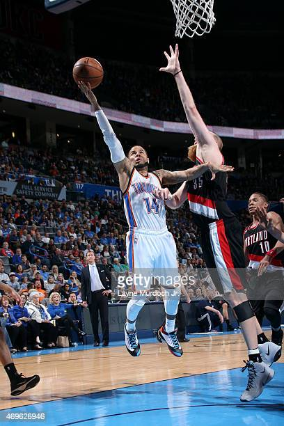 J Augustin of the Oklahoma City Thunder shoots against the Portland Trail Blazers on April 13 2015 at Chesapeake Energy Arena in Oklahoma City...