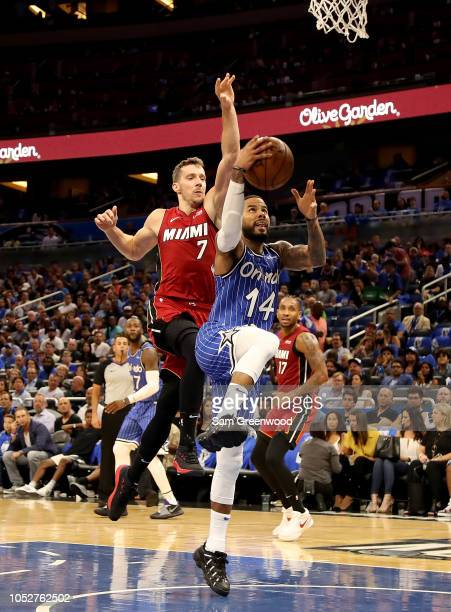 J Augustin of the Orlando Magic drives past Goran Dragic of the Miami Heat during the game at Amway Center on October 17 2018 in Orlando Florida NOTE...