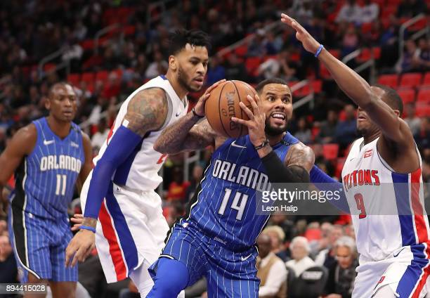 J Augustin of the Orlando Magic drives the ball to the basket as Langston Galloway of the Detroit Pistons defends during the fourth quarter of the...