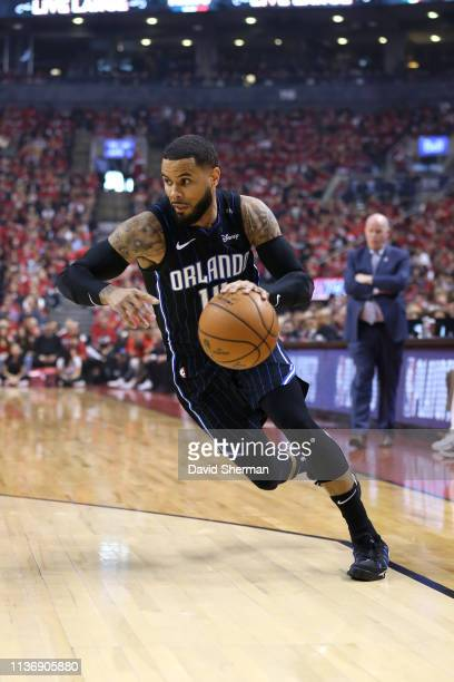 J Augustin of the Orlando Magic drives to the basket against the Toronto Raptors during Game One of Round One of the 2019 NBA Playoffs on April 13...