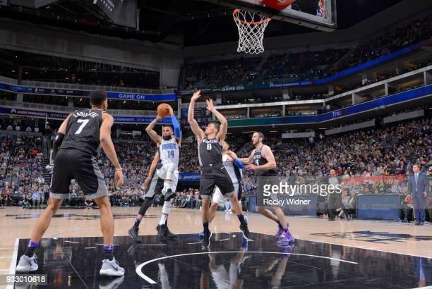 J Augustin of the Orlando Magic passes against Bogdan Bogdanovic of the Sacramento Kings on March 9 2018 at Golden 1 Center in Sacramento California...