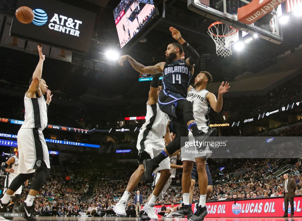 D.J. Augustin #14 of the Orlando Magic passes off against the San Antonio Spurs at AT&T Center on March 13, 2018 in San Antonio, Texas.