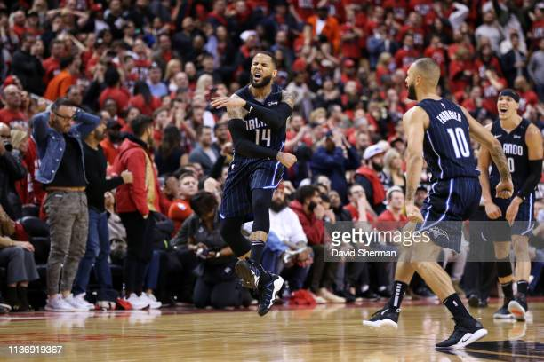 J Augustin of the Orlando Magic reacts to shooting the gamewinning three point basket against the Toronto Raptors during Game One of Round One of the...