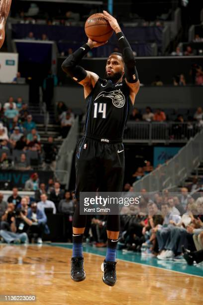 J Augustin of the Orlando Magic shoots a three point basket during the game against the Charlotte Hornets on April 10 2019 at Spectrum Center in...