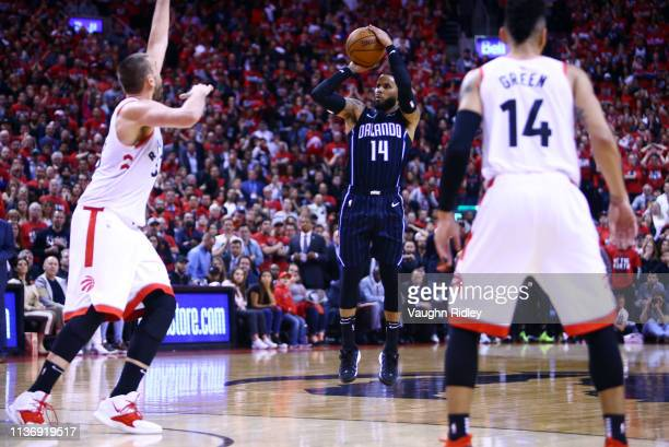 J Augustin of the Orlando Magic shoots the game winning shot during Game One of the first round of the NBA playoffs against the Toronto Raptors at...