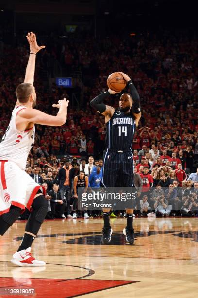J Augustin of the Orlando Magic shoots the game winning threepointer against the Toronto Raptors during Game One of Round One of the 2019 NBA...