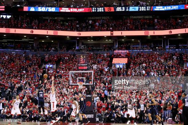 J Augustin of the Orlando Magic shoots the gamewinning three point basket against the Toronto Raptors during Game One of Round One of the 2019 NBA...