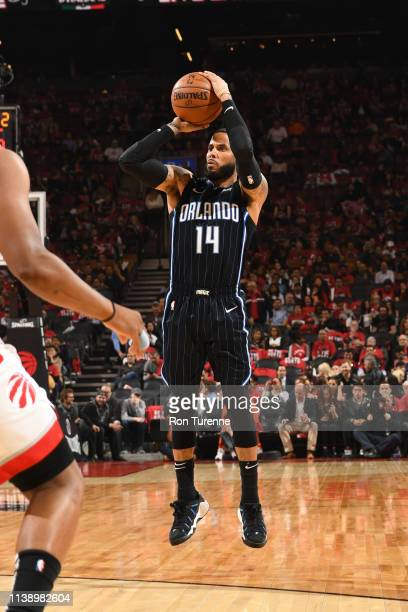 J Augustin of the Orlando Magic shoots three point basket against the Toronto Raptors during Game Five of Round One of the 2019 NBA Playoffs on April...