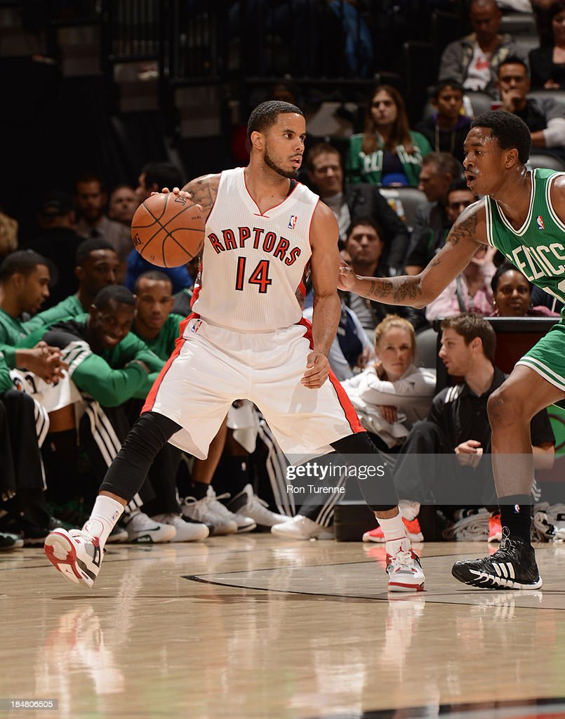 D.J. Augustin #14 of the Toronto Raptors controls the ball against MarShon Brooks #12 of the Boston Celtics during the game on October 16, 2013 at the Air Canada Centre in Toronto, Ontario, Canada.
