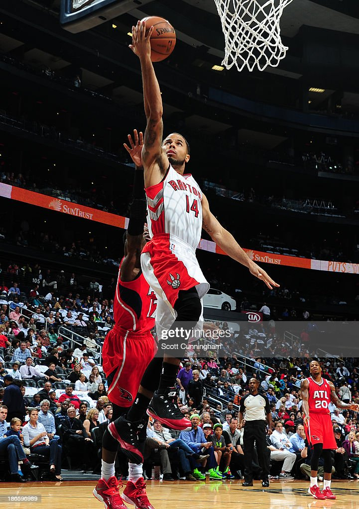 D.J. Augustin #14 of the Toronto Raptors drives to the basket against the Atlanta Hawks on November 1, 2013 at Philips Arena in Atlanta, Georgia.