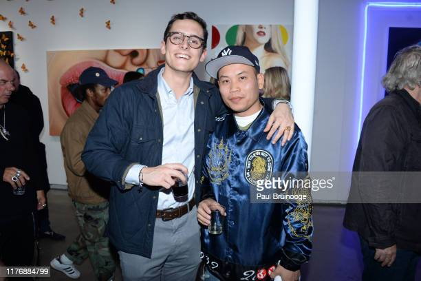 Augustine Baugier and Augustine Chen attend Delusions of the Wild Solo Exhibition By Alexandra Houx Grounds at 213 Bowery on October 17 2019 in New...