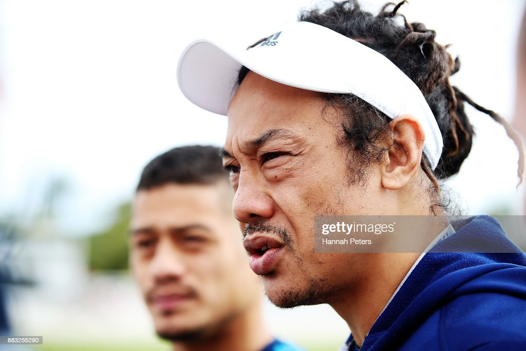 Augustine Pulu and head coach Tana Umaga talk to the media during an Auckland Blues Super Rugby pre season training session ahead of the 2018 Investec Super Rugby Championship at Alexandra Park on December 1, 2017 in Auckland, New Zealand.