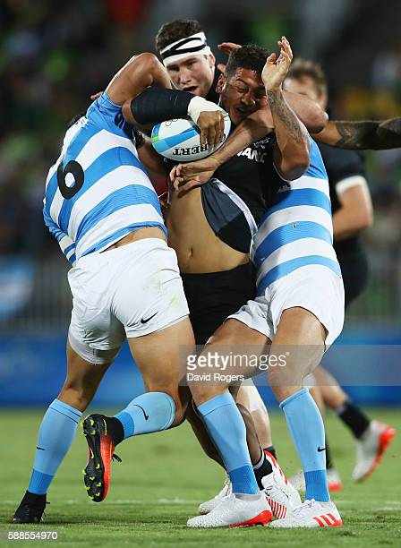 Augustine Pulu of New Zealand is held up in the tackle during the Men's Rugby Sevens placing 56 match between New Zealand and Argentina on Day 6 of...