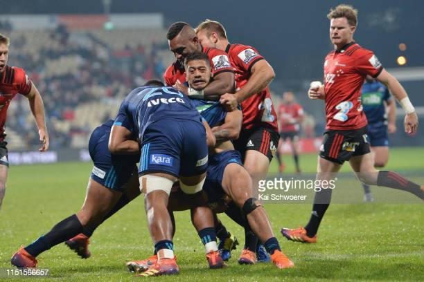 Augustine Pulu of the Blues is tackled by Sevu Reece of the Crusaders during the round 15 Super Rugby match between the Crusaders and the Blues at...