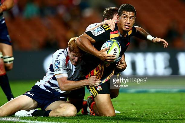 Augustine Pulu of the Chiefs is tackled by Nic Stirzaker of the Rebels during the round nine Super Rugby match between the Chiefs and the Rebels at...