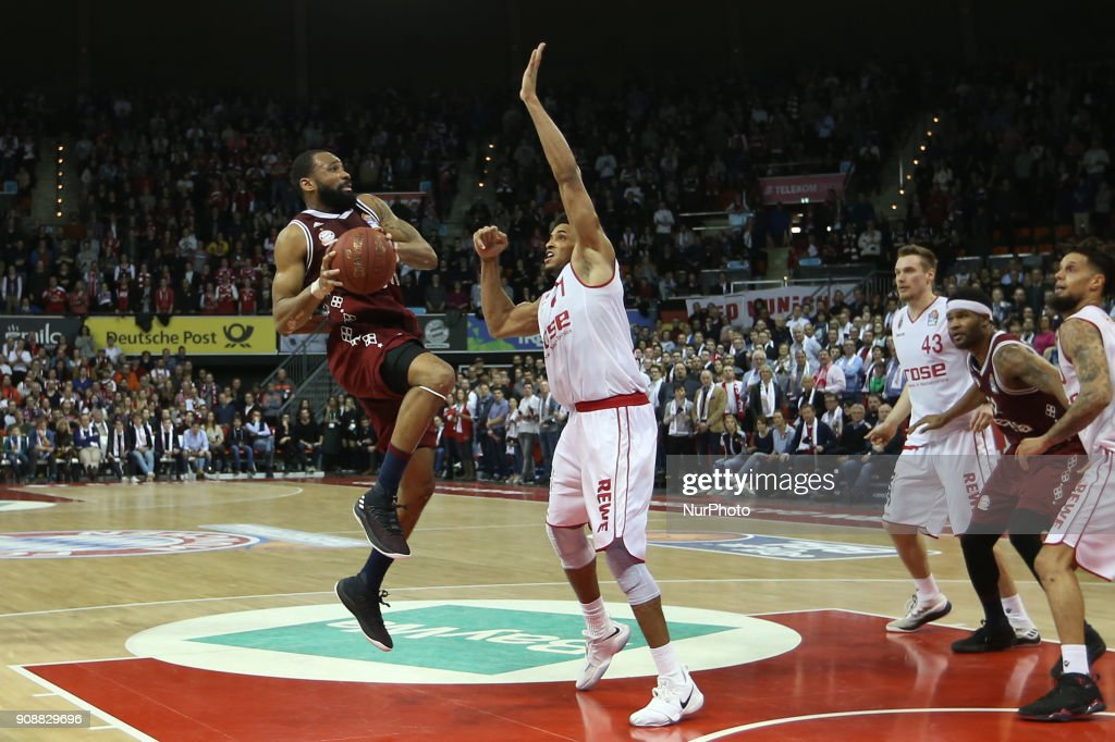 Augustine Rubit of Brose Baskets Bamberg vies Reggie Redding of Bayern Muenchen during the Quarterfinal match in the BBL Pokal 2017/18 between FC Bayern Basketball and Brose Baskets Bamberg at the Audi Dome on January 21,2018.