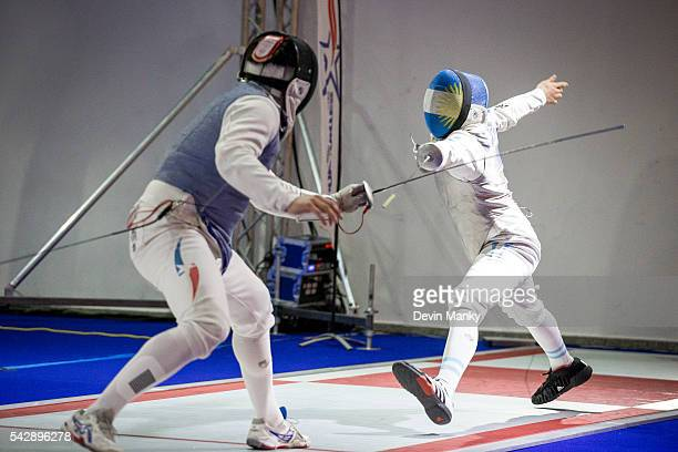 Augusto Antonio Servello of Argentina attacks Felipe Alvear of Chile during Team Men's Foil competition at the PanAmerican Fencing Championships on...