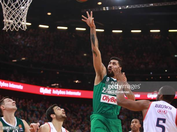 Augusto Cesar Lima #23 of Zalgiris Kaunas competes with Derrick Brown #5 of Anadolu Efes Istanbul in action during the 2016/2017 Turkish Airlines...