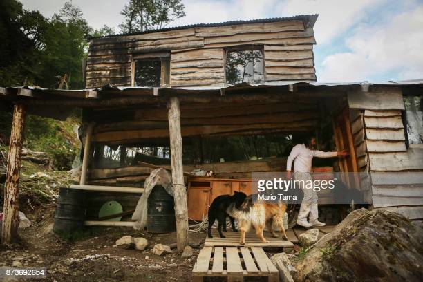 Augusto enters his home built in an informal mountainside community whose residents depend on runoff water from the receding Martial Glacier on...