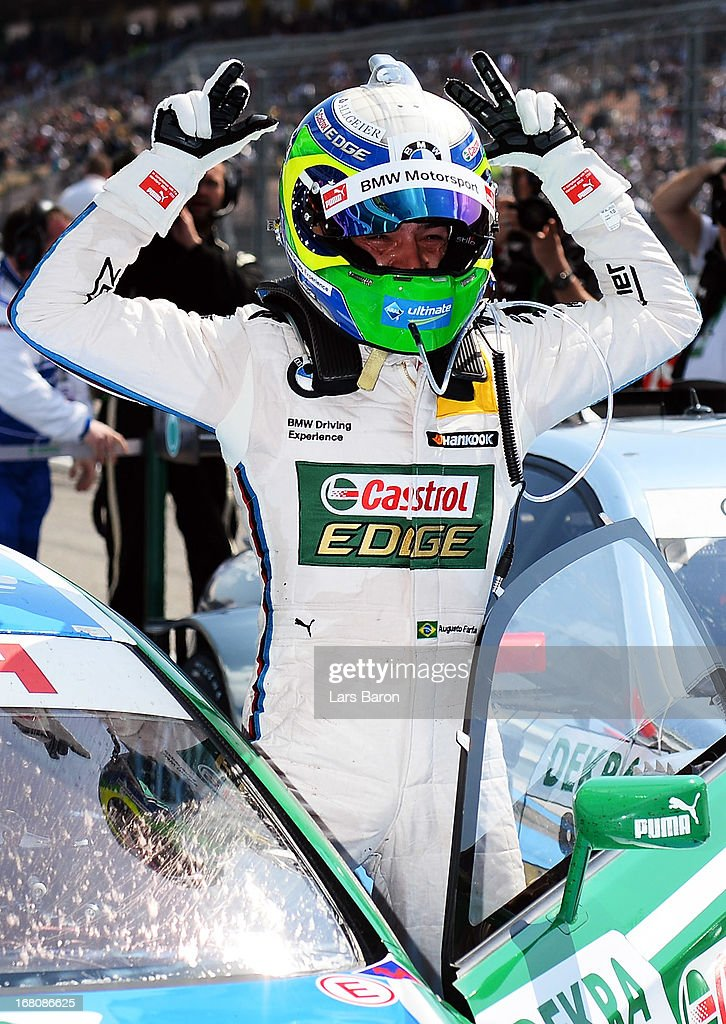 Augusto Farfus of Brazil and BMW Team RBM celebrates after winning the first round of the DTM 2013 German Touring Car Championship at Hockenheimring on May 5, 2013 in Hockenheim, Germany.