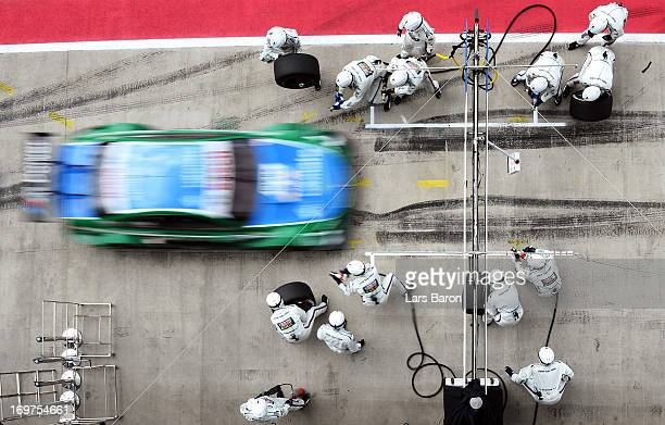 Augusto Farfus of Brazil and BMW Team RBM makes a pit stop during the training session for the third round of the DTM 2013 German Touring Car...