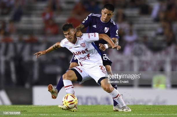 Augusto Lotti of Union fights for the ball with Enzo Perez of River Plateduring a match between River Plate and Union as part of Round 12 of...