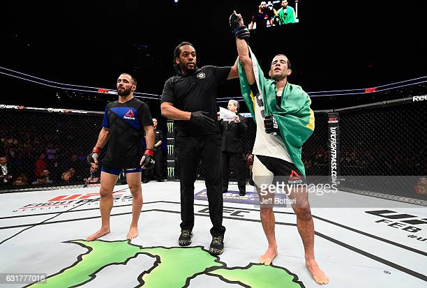 Augusto Mendes of Brazil celebrates his victory over Frankie Saenz after their bantamweight bout during the UFC Fight Night event inside Talking...