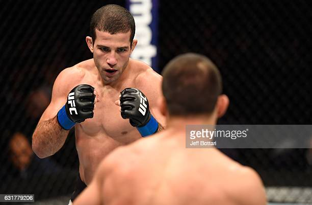 Augusto Mendes of Brazil circles Frankie Saenz in their bantamweight bout during the UFC Fight Night event inside Talking Stick Resort Arena on...