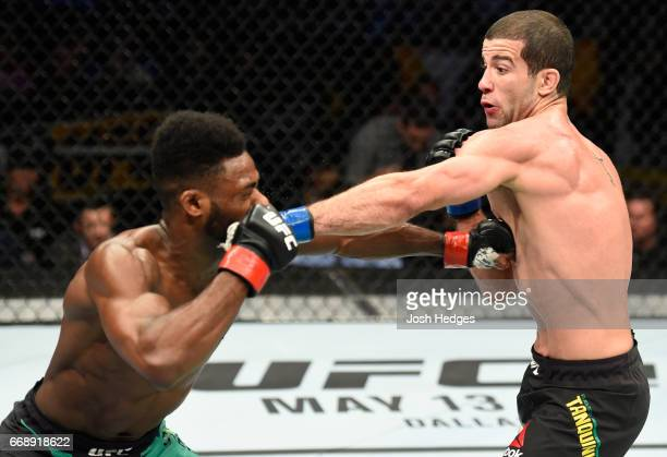 Augusto Mendes of Brazil punches Aljamain Sterling in their bantamweight fight during the UFC Fight Night event at Sprint Center on April 15 2017 in...