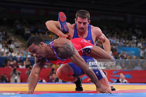 Augusto Midana of GuineaBissau and Davit Khutsishvili of Georgia compete in the Men's Freestyle 74 kg Wrestling on Day 14 of the London 2012 Olympic...