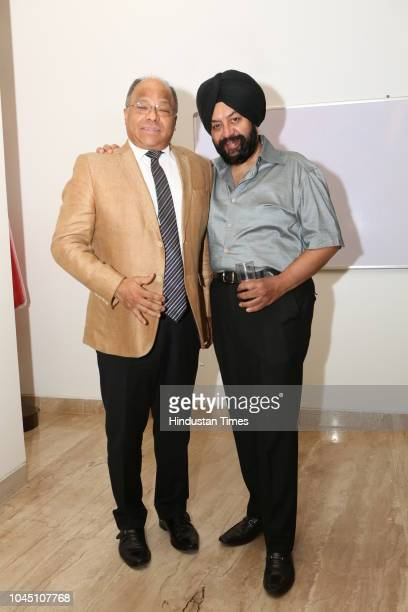 Augusto Montiel, Ambassador of Venezuela to India, and PS Anand during a photography exhibition 'La Virgen de la Candelaria' at the Art Gallery of...