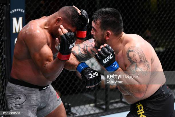 Augusto Sakai of Brazil elbows Alistair Overeem of the Netherlands in a heavyweight fight during the UFC Fight Night event at UFC APEX on September...