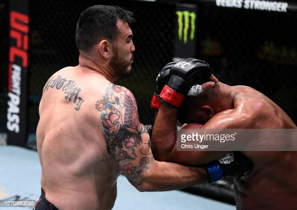 Augusto Sakai of Brazil punches Alistair Overeem of the Netherlands in a heavyweight fight during the UFC Fight Night event at UFC APEX on September...