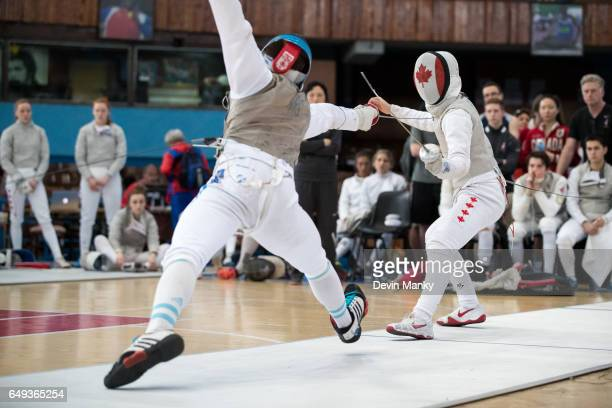 Augusto Servello of Argentina fences Blake Broszus of Canada during competition in the Junior Team Men's Foil competition at the Cadet and Junior...