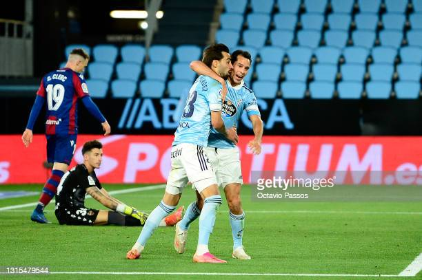 Augusto Solari of Celta Vigo celebrates with a team mate after scoring his team's second goal during the La Liga Santander match between RC Celta and...
