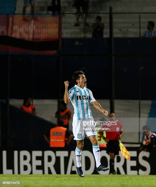 Augusto Solari of Racing celebrates after scoring the fourth goal of his team during a Group E match between Racing Club and Cruzeiro as part of Copa...