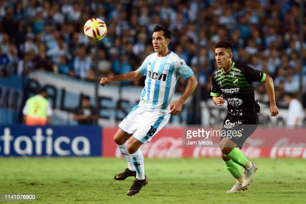 Augusto Solari of Racing Club and Matias Rojas of Defensa y Justicia fight for the ball during a match between Racing Club and Defensa y Justicia as...