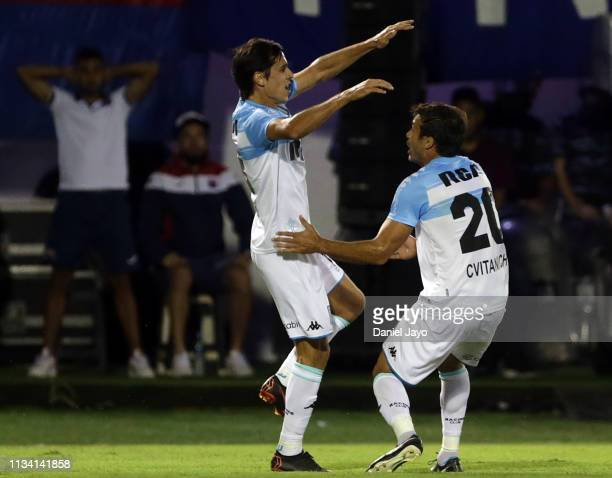 Augusto Solari of Racing Club celebrates with teammate Dario Cvitanich of Racing Club after scoring the first goal of his team during a match between...