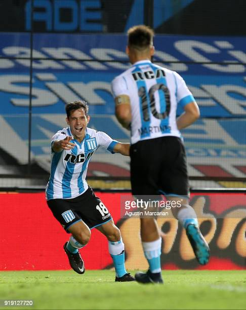 Augusto Solari of Racing Club celebrates with teammate Lautaro Martinez after scoring the third goal of his team during a match between Racing Club...